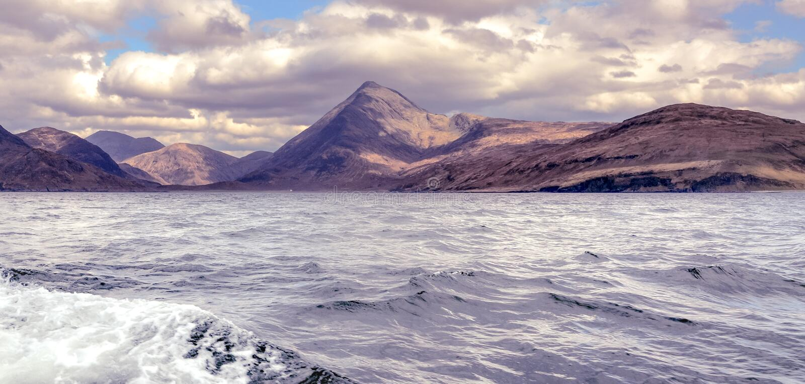 Cuillin mountain range seen from the boat - Isle of Skye royalty free stock image