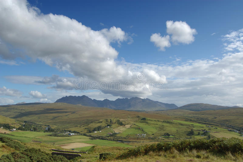 Cuillins and Carbostmore with big cloud. The Cuillins of Skye from a viewpoint near Carbostmore on the west coast stock images