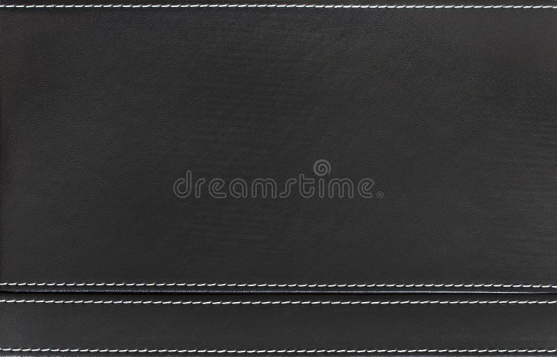 Cuir noir avec des coutures en gros plan photographie stock