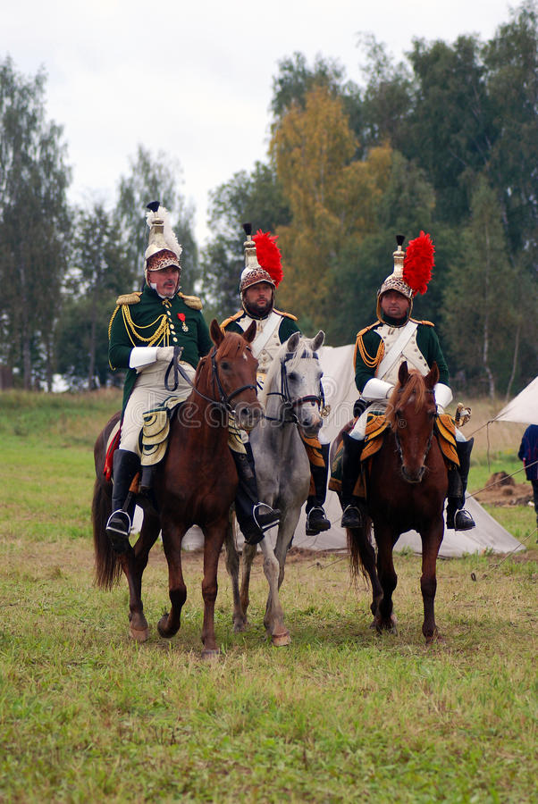 Cuirassiers at at Borodino battle historical reenactment in Russia. BORODINO, MOSCOW REGION - SEPTEMBER 04, 2016: Reenactors dressed as Napoleonic war soldiers stock images