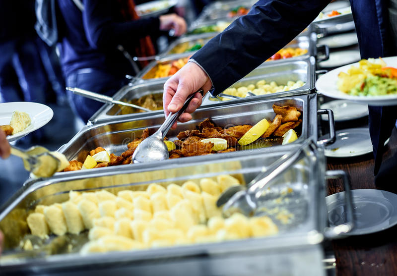 Cuisine Culinary Buffet Dinner Catering Dining Food Celebration. Party Concept. Group of people in all you can eat catering buffet food indoor in luxury stock photos