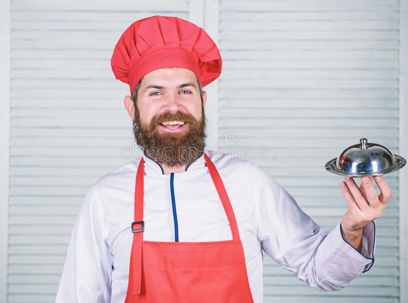 Cuisine culinary. man holds kitchen dish tray in restaurant. Healthy food cooking. Mature hipster with beard. Dieting. Organic food. Happy bearded man. chef stock photography
