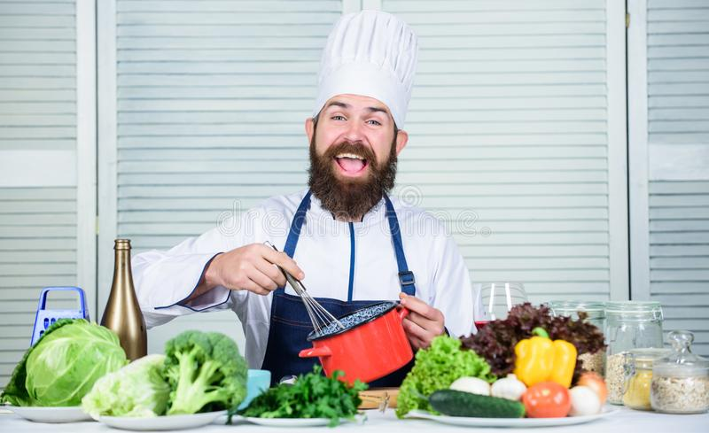 Cuisine culinary. Vitamin. Vegetarian salad with fresh vegetables. Healthy food cooking. Mature hipster with beard. Dieting organic food. Happy bearded man stock image