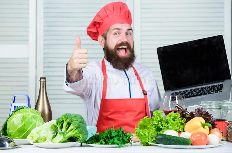 Cuisine culinary. Vitamin. Vegetarian salad with fresh vegetables. Healthy food cooking. Mature hipster with beard stock photo