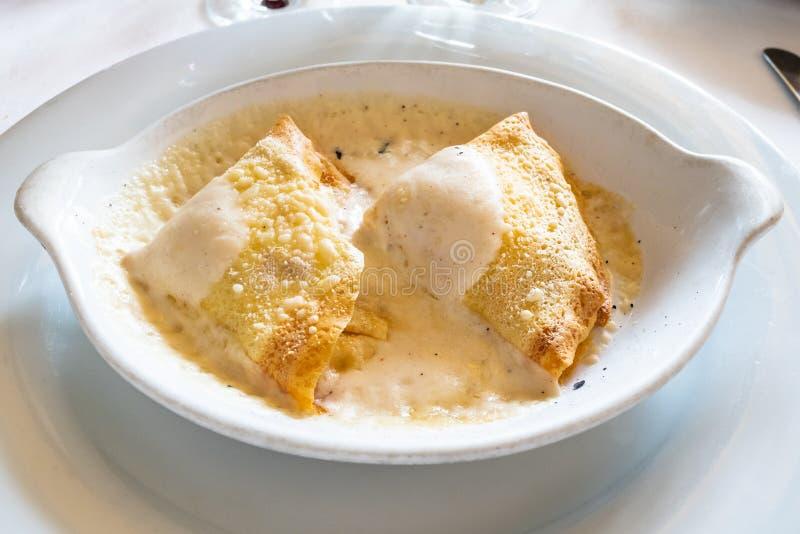 Cuisine italienne - alla de crespelle valtellinese photo libre de droits