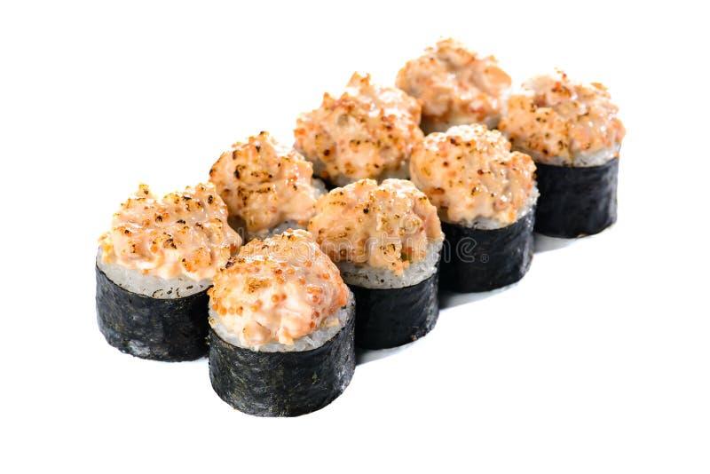 Cuisine japonaise traditionnelle Ensemble de petits pains de sushi faits de saumons photographie stock libre de droits
