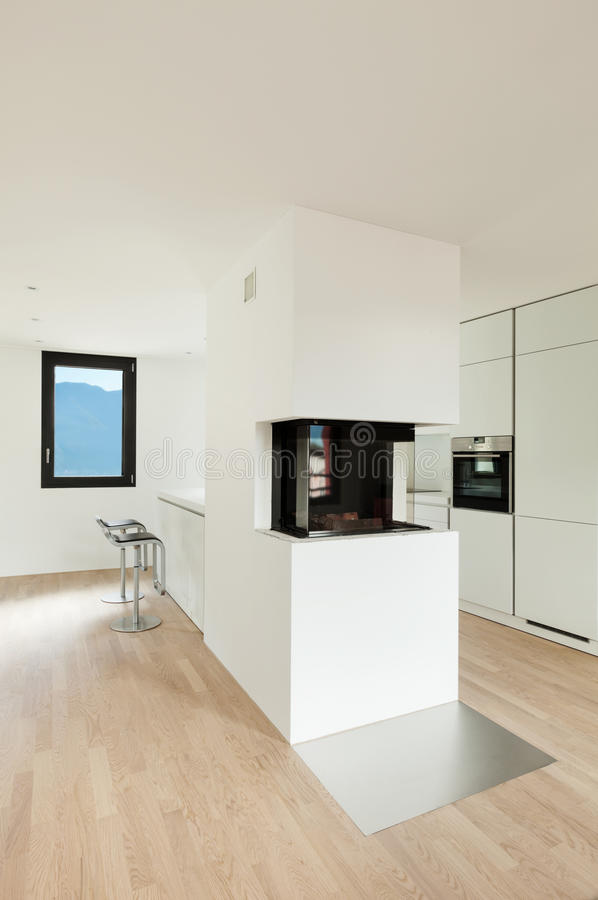 cuisine moderne avec la chemin e image stock image du confort personne 31537937. Black Bedroom Furniture Sets. Home Design Ideas
