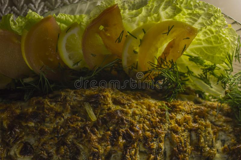 Stuffed carp, decorated with vegetables. Fish dish. stock photo