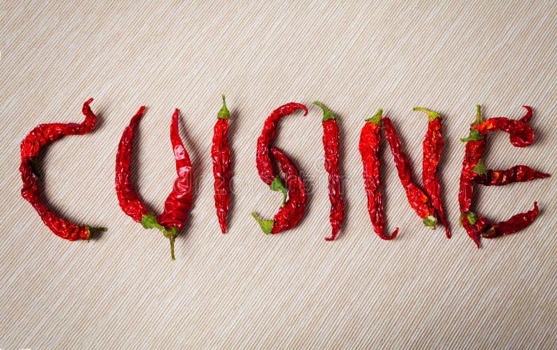 cuisine Wort mit getrocknetem glühendem Paprikapfeffer stockbild