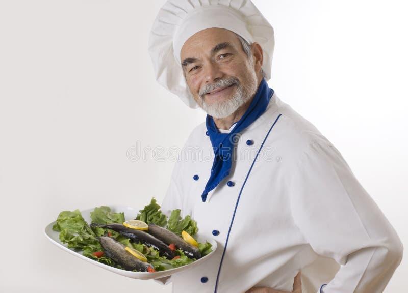 Cuisinier attirant heureux photographie stock