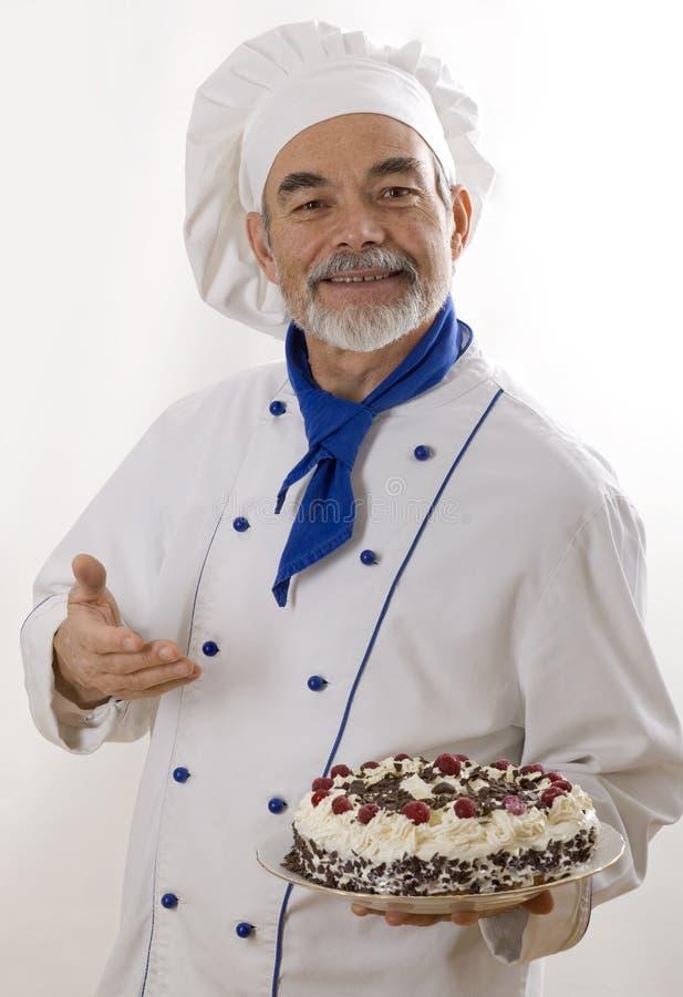 Cuisinier attirant heureux photo stock