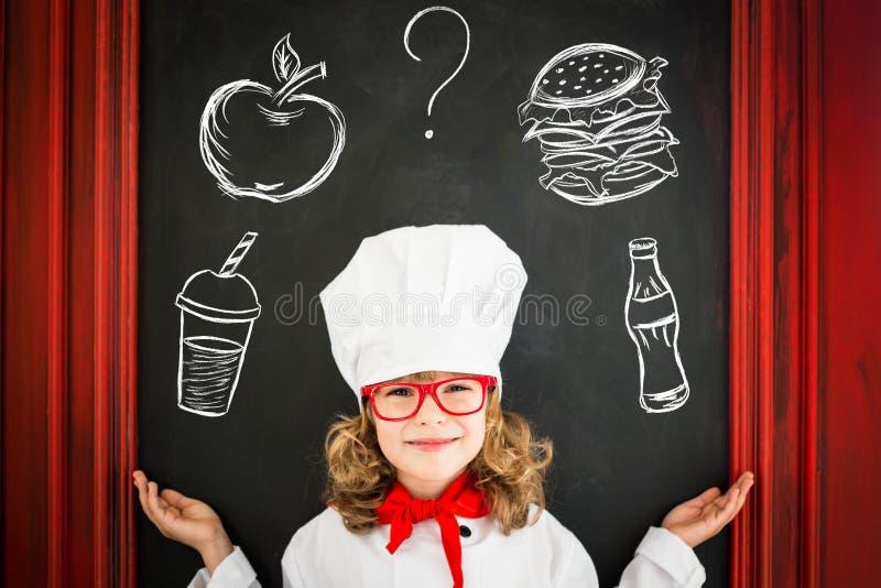 Cuisinier de chef d'enfant Concept de restauration photo stock