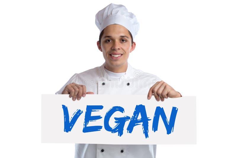 Cuisinier de nourriture de Vegan faisant cuire les légumes sains de consommation d'isolement image libre de droits