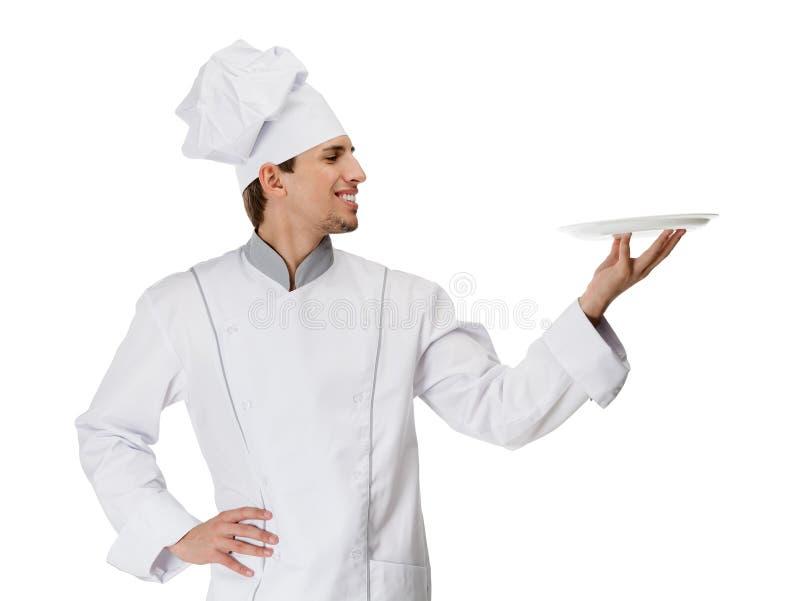 Cuisinier en chef remettant une plaque blanche images libres de droits