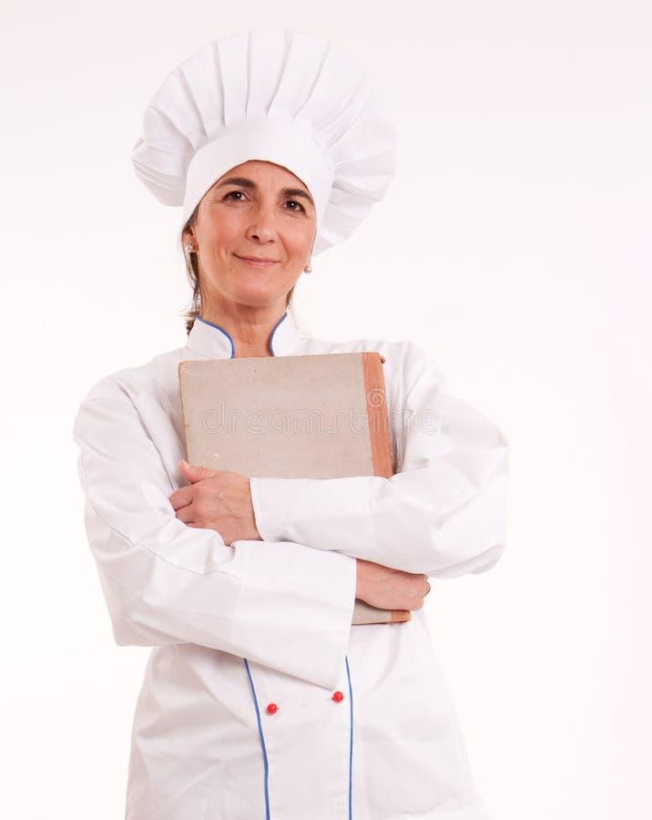 Cuisinier féminin avec le livre photographie stock libre de droits