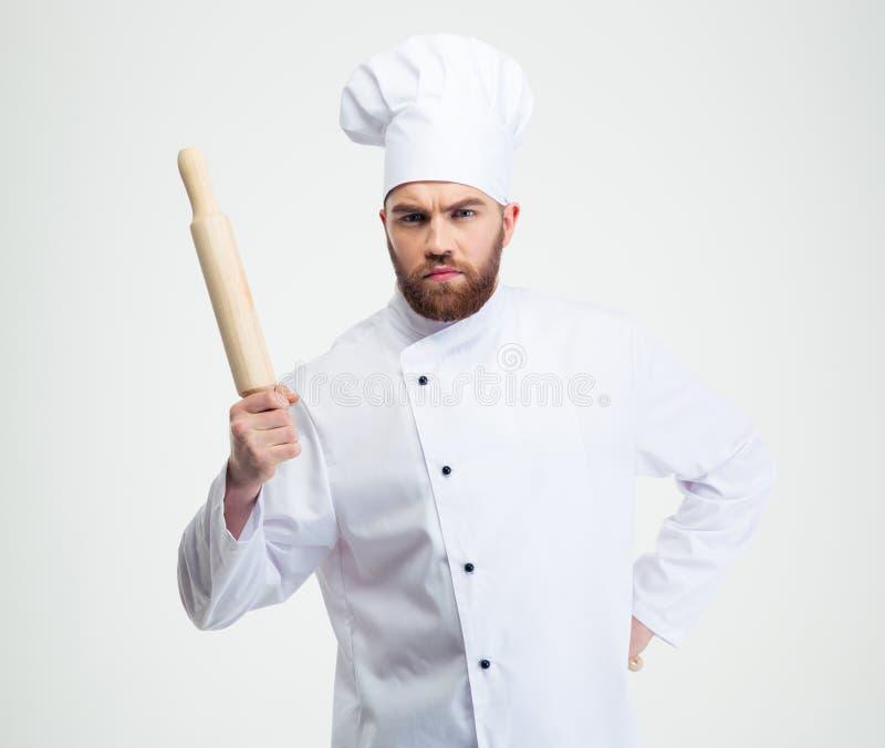 Cuisinier masculin sérieux de chef tenant une goupille photographie stock libre de droits
