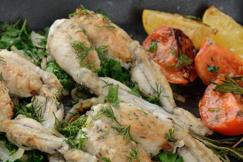 Cuisses de grenouilles frites photographie stock