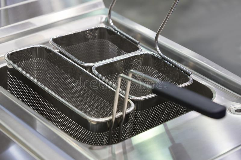 Cuisson à la friteuse de la surface pour la cuisson photos libres de droits