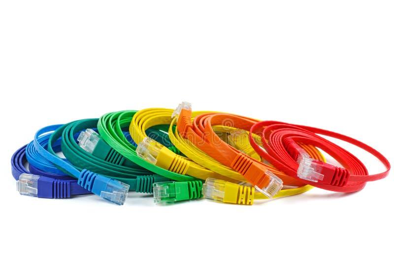 Cuivre Ethernet plat, cordons RJ45 isolés photos stock