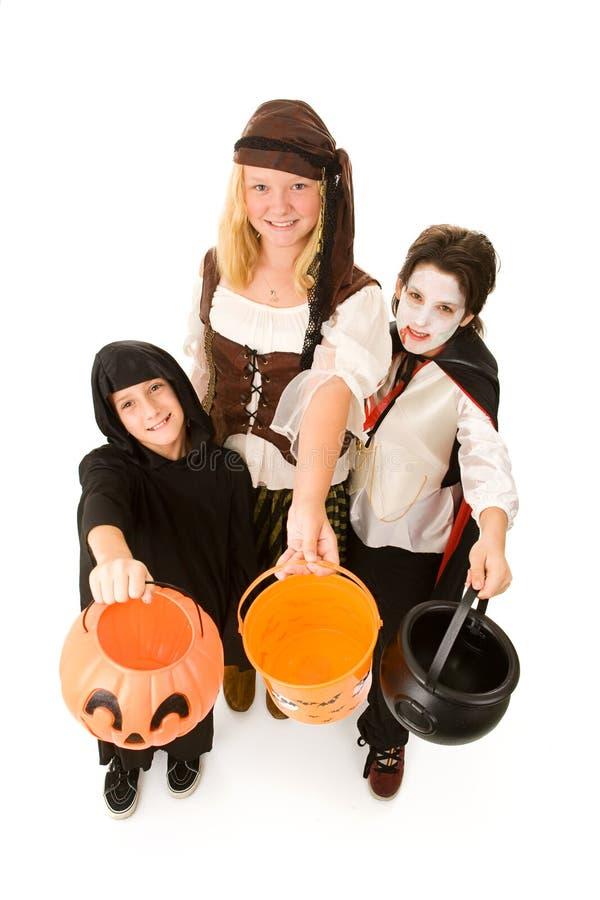 cukierków Halloween dzieciaki chcą zdjęcia royalty free