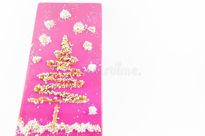 Cukierki dekorujący drzewo fotografia royalty free