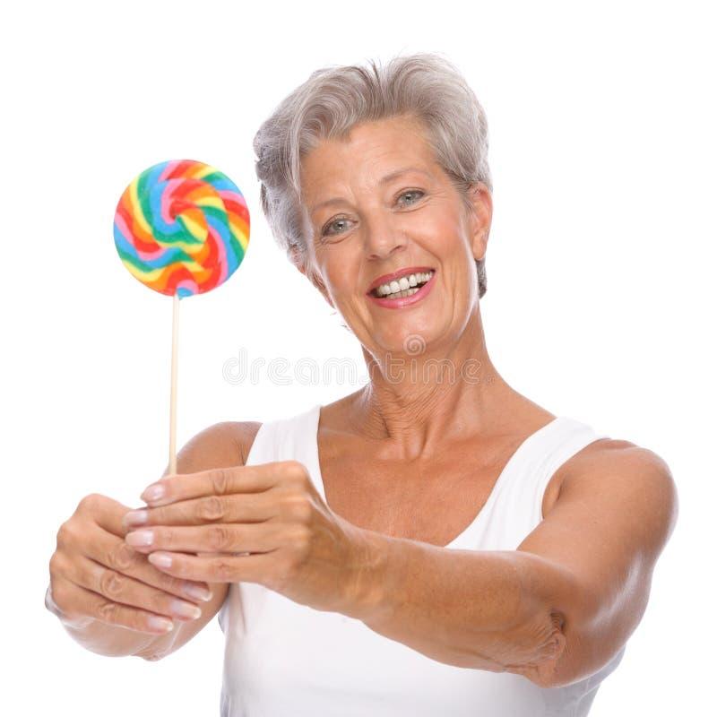 cukierki starsza kobieta zdjęcia stock