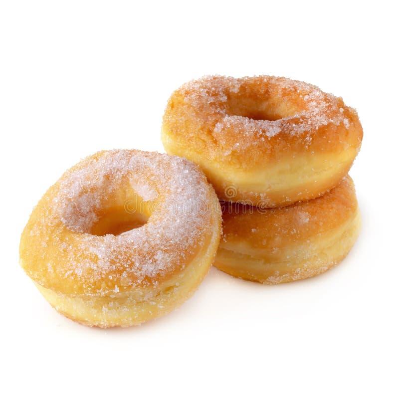 Cukierkowi donuts odizolowywający nad białym tłem fotografia royalty free