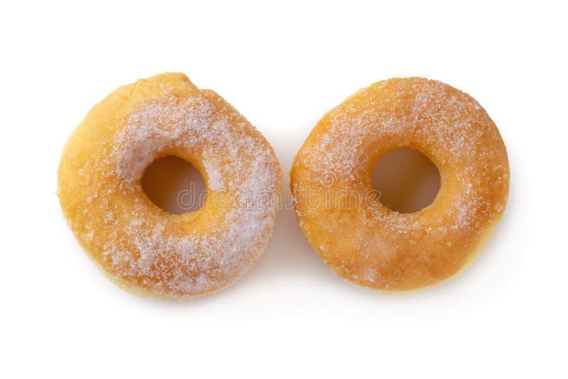 Cukierkowi donuts odizolowywający nad białym tłem obraz royalty free
