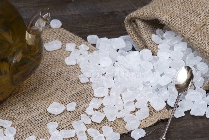 Cukierku cukier w kieszonce rozpraszającej na stołowym zakończeniu up obrazy royalty free