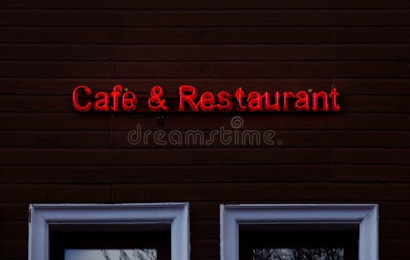 Cukierniany Restauracyjny Neonowy śpiewa na drewnie zdjęcie royalty free