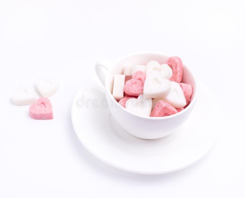 Cukrowy Biały filiżanka cukier w kształcie serce kopii przestrzeni walentynki tła Horyzontalny Stonowany fotografia stock