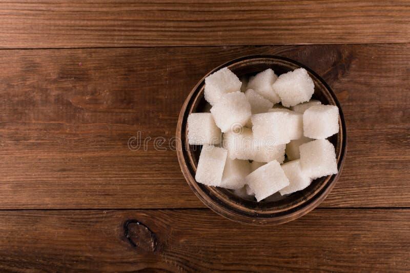 Cukrzyce Mnóstwo cukrowi sześciany w słoju zdjęcia stock
