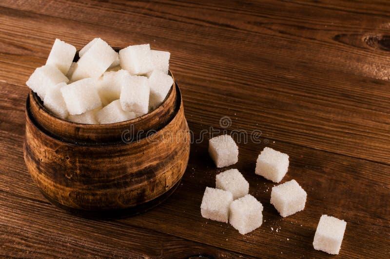 Cukrzyce Mnóstwo cukrowi sześciany w słoju fotografia stock