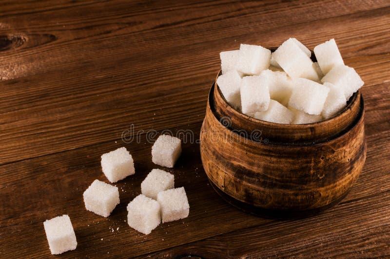 Cukrzyce Mnóstwo cukrowi sześciany w słoju fotografia royalty free