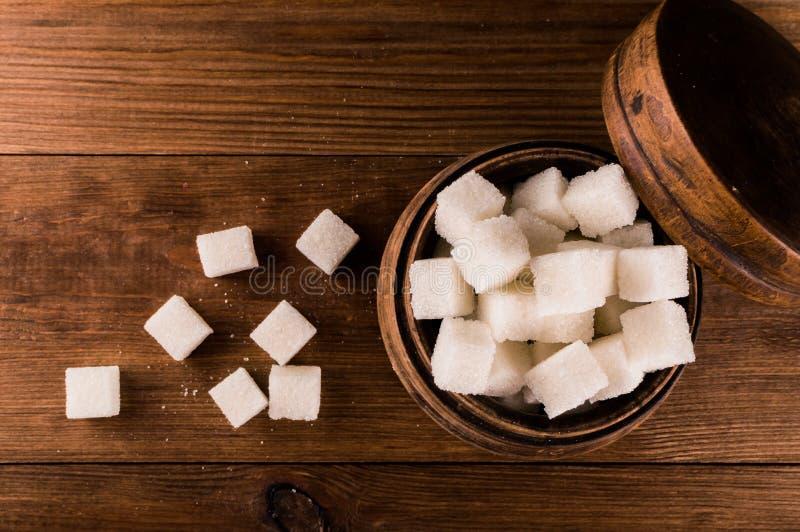 Cukrzyce Mnóstwo cukrowi sześciany w słoju obrazy stock