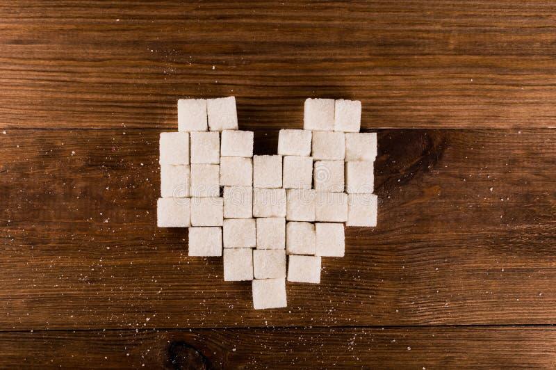 Cukrzyce są okropnym chorobą Serce cukrowi sześciany zdjęcia royalty free