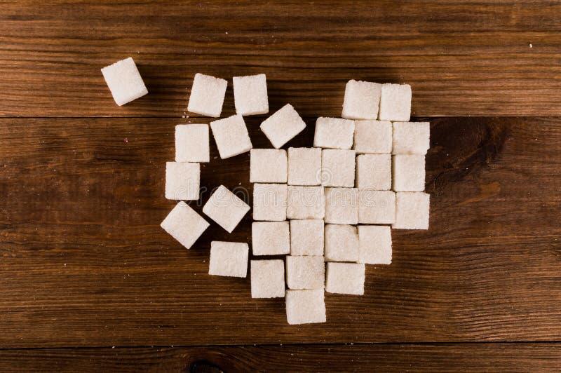 Cukrzyce są okropnym chorobą Serce cukrowi sześciany zdjęcie royalty free