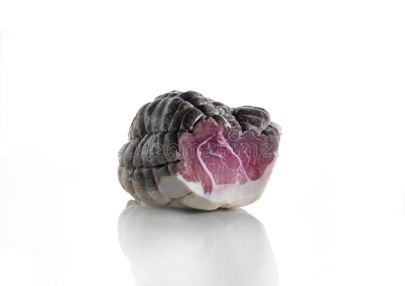 Culatello, aria ha curato la carne suina su fondo bianco fotografia stock libera da diritti