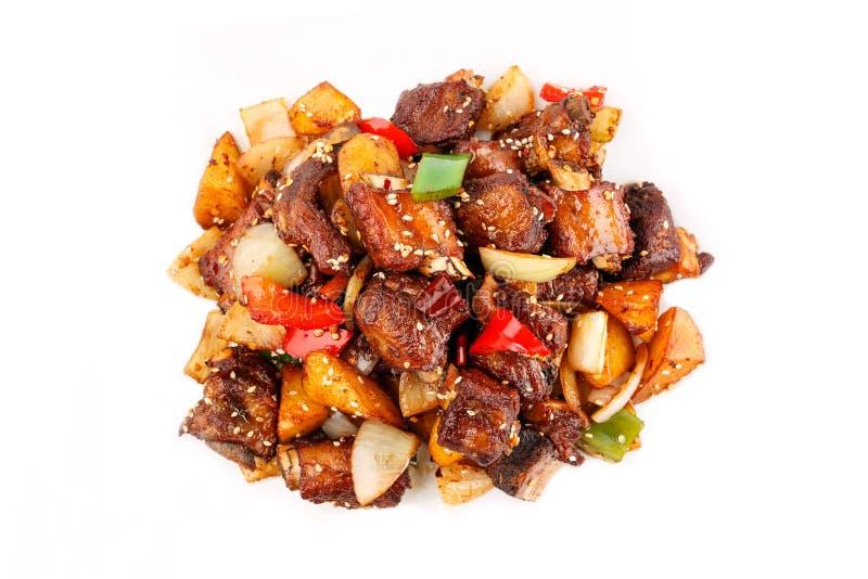Culinária chinesa Reforços de carne de porco Roasted no fundo branco fotografia de stock