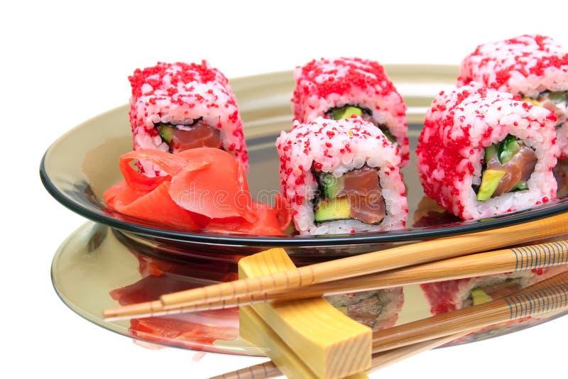 Culinária japonesa - rolos com salmões e abacate imagens de stock royalty free