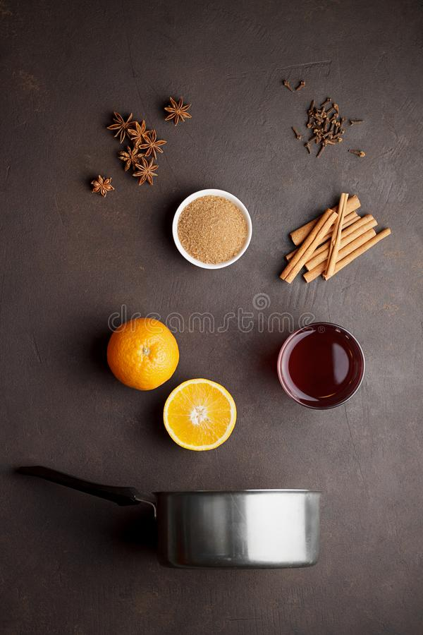 Culinary background with ingredients for mulled wine on brown stone table. Recipe of christmas hot drink top view stock photography