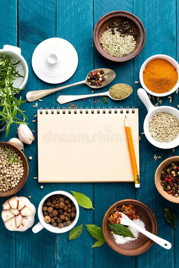 Culinary background and recipe book with spices on wooden table culinary background and recipe book with various spices on wooden table forumfinder Gallery