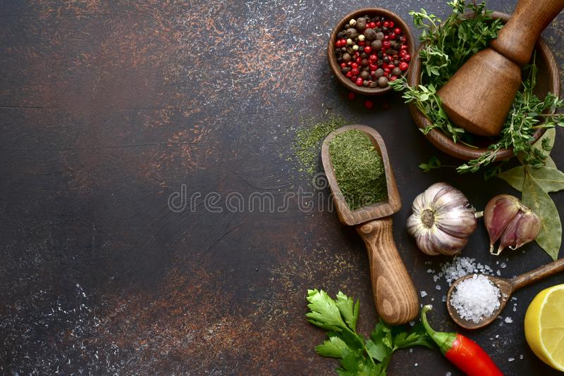 Culinary background with selection of spices, herbs and greens.Top view with copy space stock images
