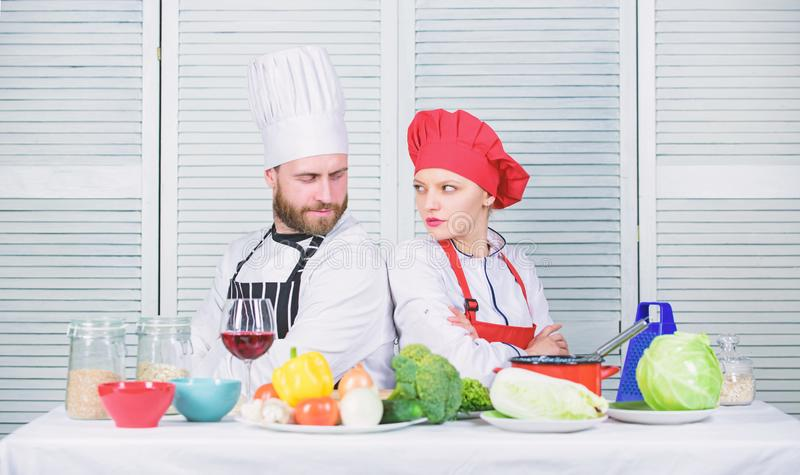 Culinary battle concept. Woman and bearded man culinary show competitors. Who cook better. Ultimate cooking challenge. Culinary battle concept. Woman and bearded stock photos