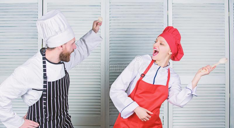 Culinary battle concept. Woman and bearded man culinary show competitors. Ultimate cooking challenge. Culinary battle of. Culinary battle concept. Woman and royalty free stock image