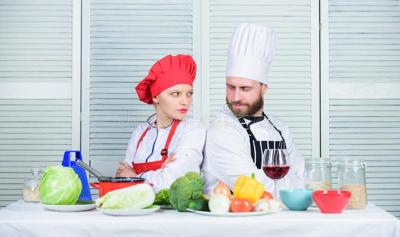 Culinary battle concept. Woman and bearded man culinary show competitors. Who cook better. Ultimate cooking challenge. Culinary battle concept. Woman and bearded stock photo