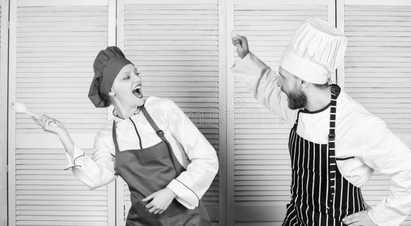 Culinary battle concept. Woman and bearded man culinary show competitors. Ultimate cooking challenge. Culinary battle of. Culinary battle concept. Woman and stock photos