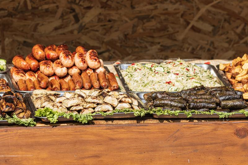 Culinary Buffet with healthy take away meal - grilled vegetables, fish and meat on the street food culinary market, festival, even. T.  Different types of royalty free stock photos