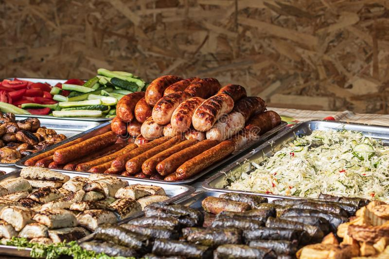 Culinary Buffet with healthy take away meal - grilled vegetables, fish and meat on the street food culinary market, festival, even. T.  Different types of stock photography