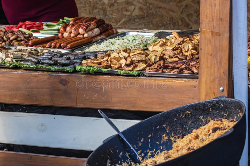 Culinary Buffet with healthy take away meal - grilled vegetables, fish and meat on the street food culinary market, festival, even. T.  Different types of stock image